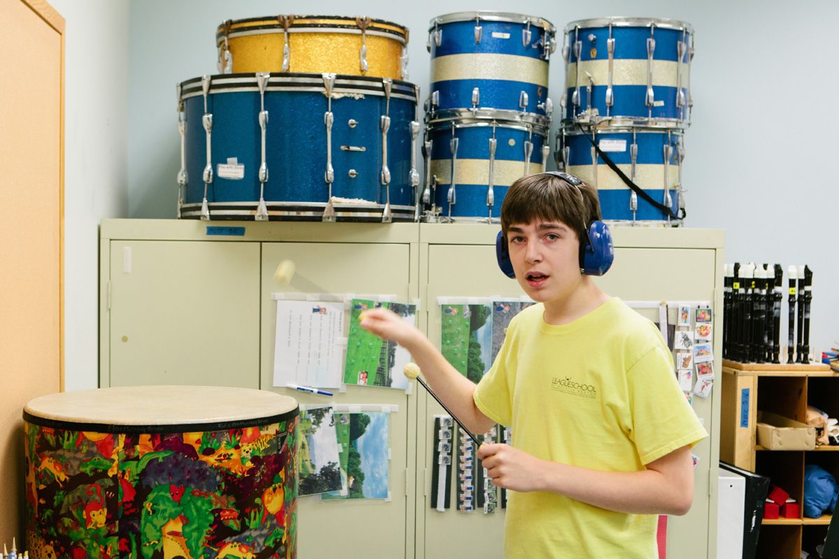Student learning to play drums