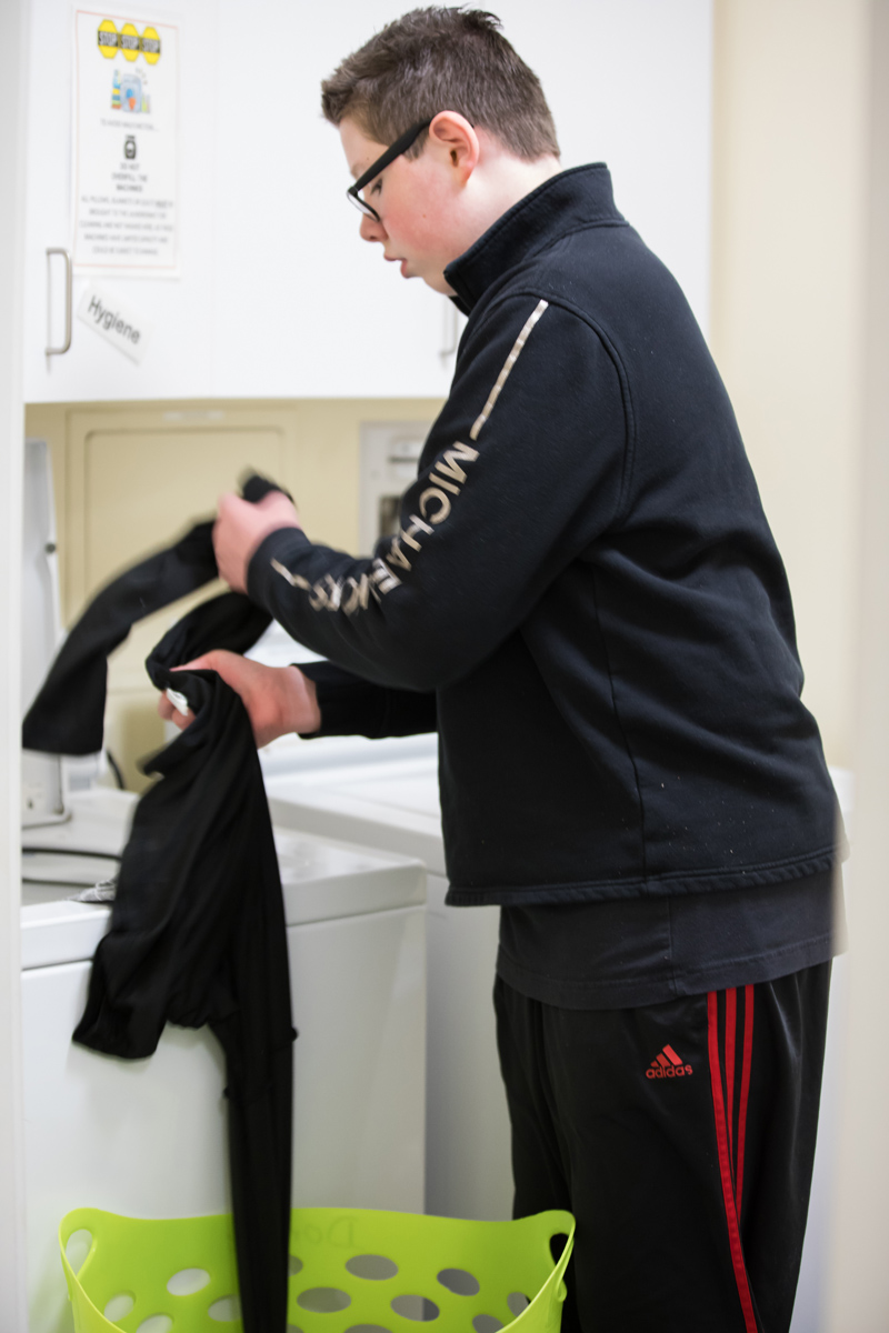 Student washing laundry
